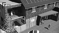 Extension d'un bâtiment et habillage en panneaux solaires d'une façade